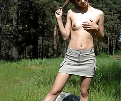 Nude teen with really exotic looks pees in forest