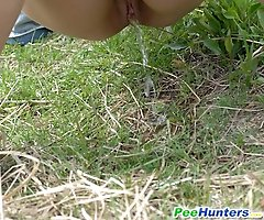 Beutiful kitty waters the grass with her piss