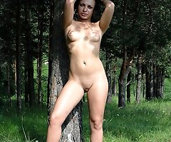 Hot brunette gets nude before pissing in the woods