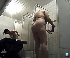 Chubby oldie rubs her snatch in spycammed shower