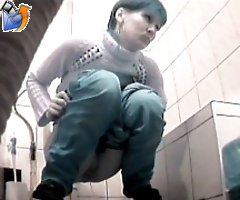 Raunchy hottie urinates onto spy cam in public loo