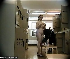 Thick nude blonde dries hair in changeroom