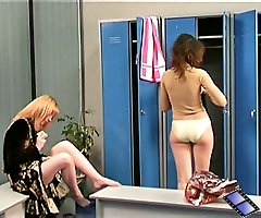 Two sexy ladies flash juicy assets in a locker room