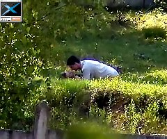 Clothed couple enjoy some pounding on the grass