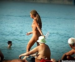 Spicy voyeur shots of beach nudity made near the sea