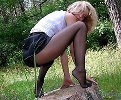 Juicy slut in the wood showing what she�s got hidden underneath her skin-tight black nylons