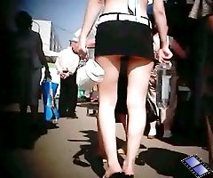 Enticing chick in short skirt in public