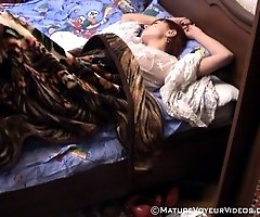 Nude sleeping milf filmed by an artful voyeur