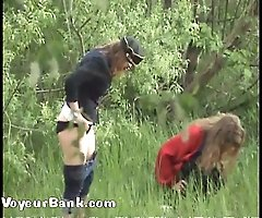 Yummy ladies tinkling outdoors - next to a spy cam